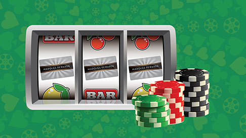Slot reels showing the Marquee Rewards card as icons with three stacks of green, red and black poker chips in front on the right hand side.
