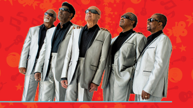 The Blind Boys of Alabama in silver suits on a red background.