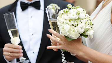 Wedding couple bride groom with bouquet rings and champagne flutes