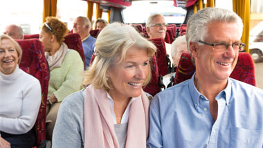 older couple on a bus trip